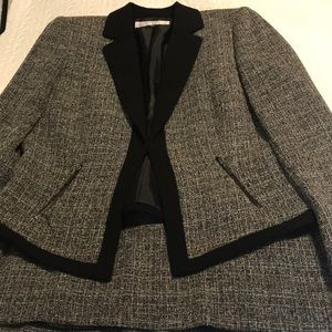 Very nice two piece dress suit. Jacket and skirt.